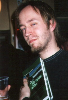 Me, with my novel in 2001.